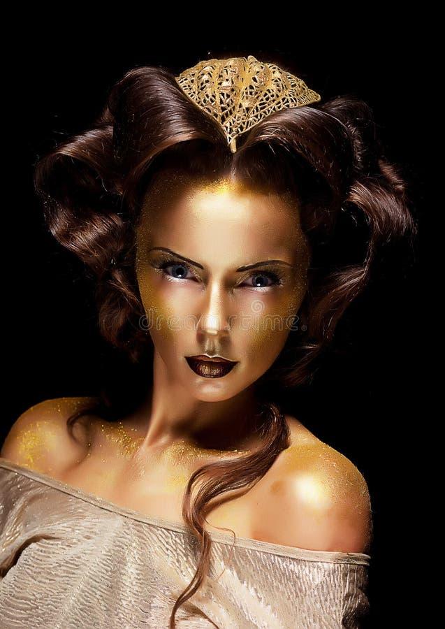 De vrouw verguldde gouden gezicht - de theaterluxe maakt omhoog royalty-vrije stock fotografie