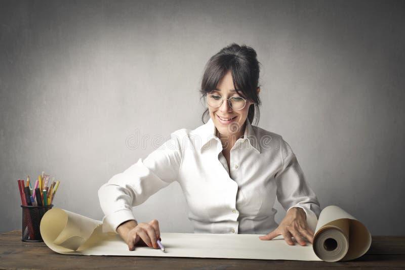 De vrouw werkt stock afbeelding