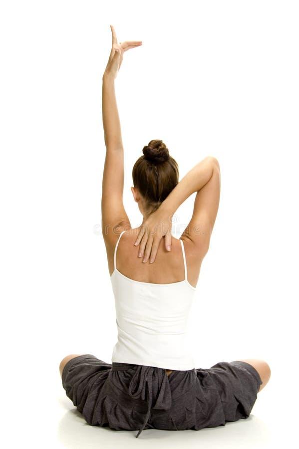 De vrouw in yoga stelt royalty-vrije stock afbeelding