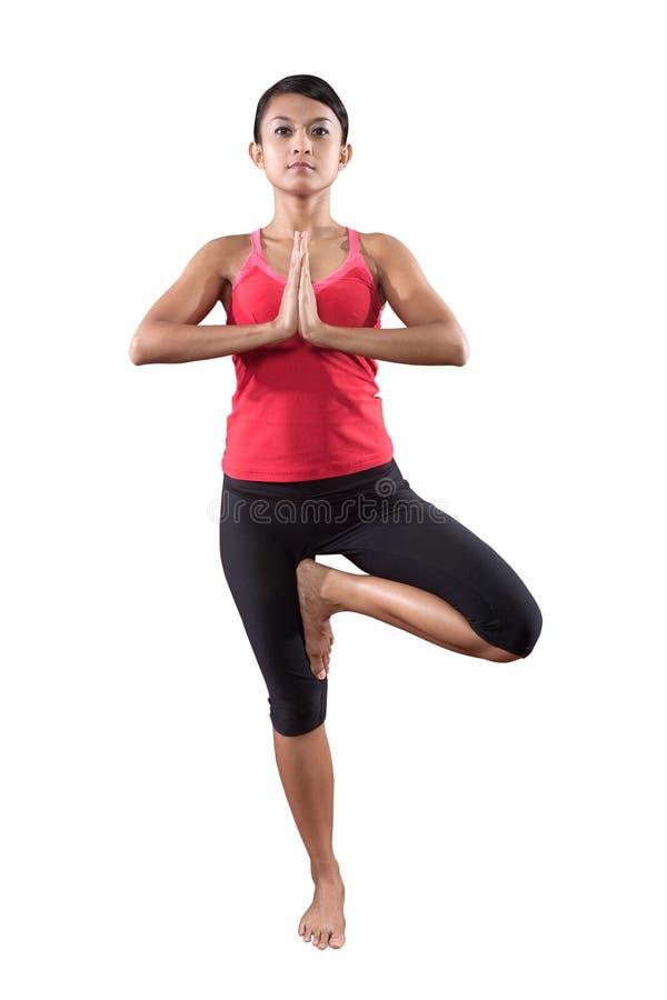De vrouw in yogaoefening stelt stock afbeeldingen