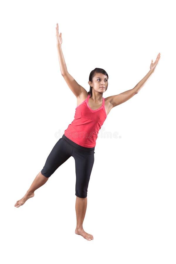 De vrouw in yogaoefening stelt royalty-vrije stock foto
