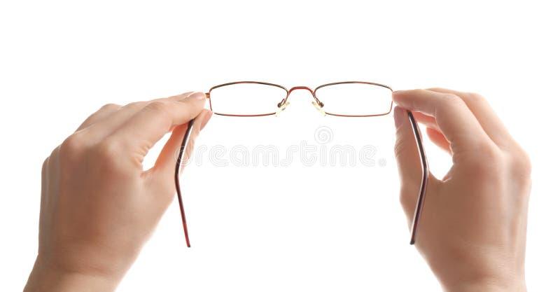 De vrouwelijke glazen van de oftalmoloogholding op witte achtergrond stock foto