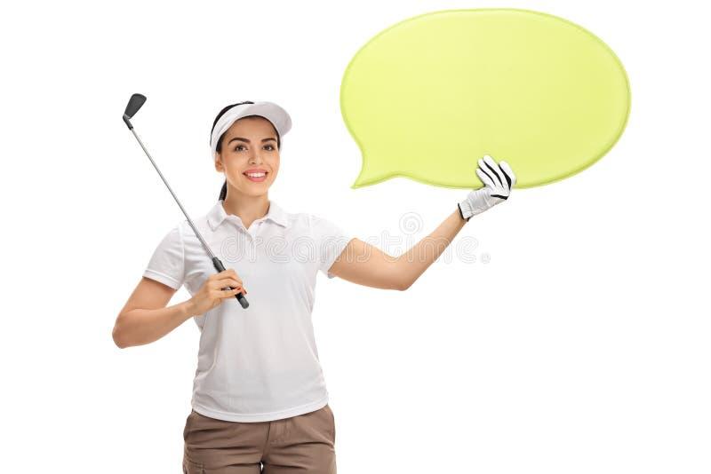 De vrouwelijke golfclub van de golfspelerholding en toespraakbel stock foto's