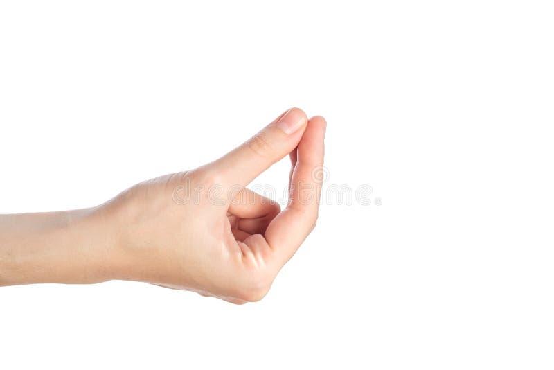 De vrouwelijke hand toont gwsture waar mijn die geld op een wit wordt geïsoleerd is stock foto