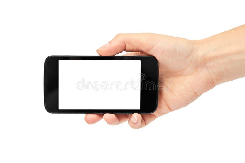 De vrouwelijke handen houden een celtelefoon, modelmalplaatje Geïsoleerdj op witte achtergrond stock foto