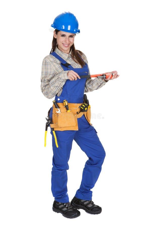 De vrouwelijke Moersleutel en Toolbox van de Holding van de Arbeider stock fotografie