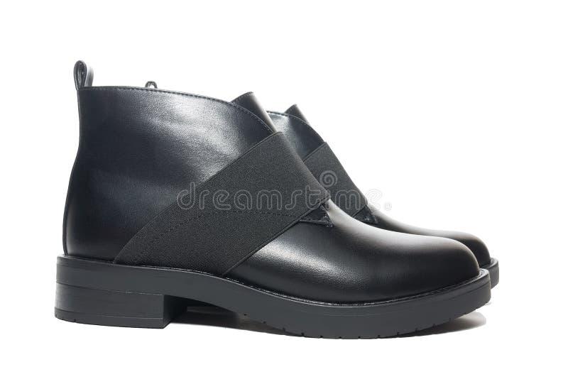 De vrouwelijke schoenen van het de winterleer royalty-vrije stock afbeeldingen
