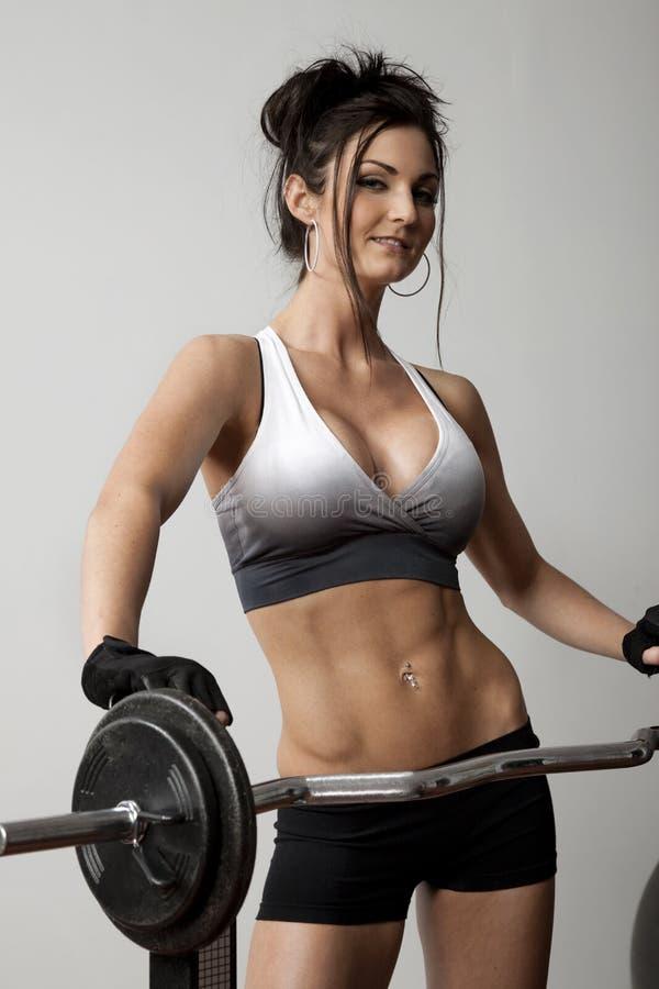 De vrouwelijke Trainer van het Gewicht stock foto