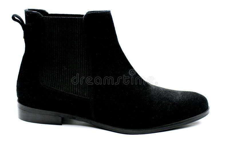 De vrouwelijke zwarte schoenen van suèdechelsee stock fotografie