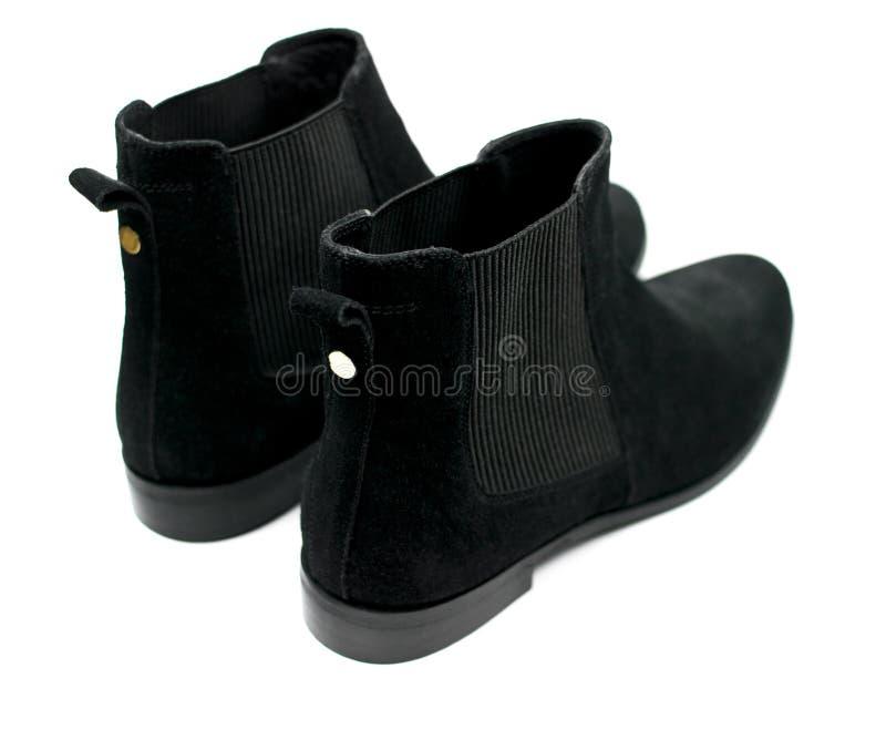 De vrouwelijke zwarte schoenen van suèdechelsee royalty-vrije stock afbeeldingen