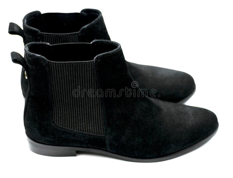 De vrouwelijke zwarte schoenen van suèdechelsee stock afbeeldingen