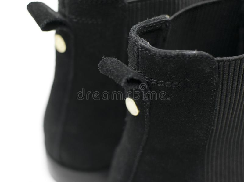 De vrouwelijke zwarte schoenen van suèdechelsee royalty-vrije stock fotografie
