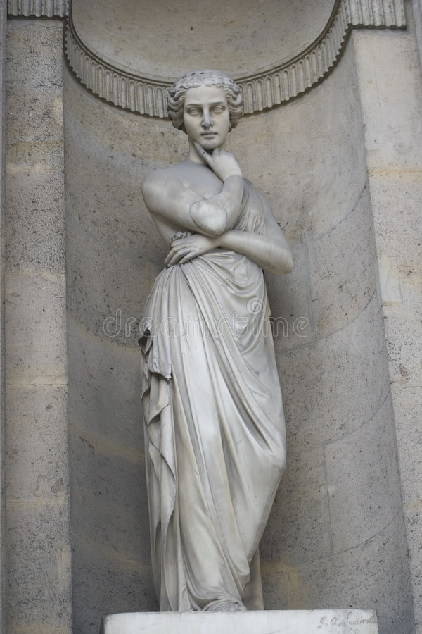 De vrouwen dwarswapens van het standbeeld stock foto's