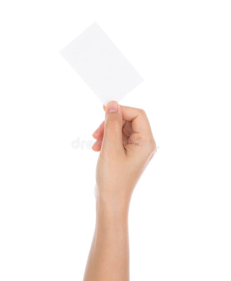 De vrouwen overhandigen holding leeg document geïsoleerd adreskaartje stock fotografie