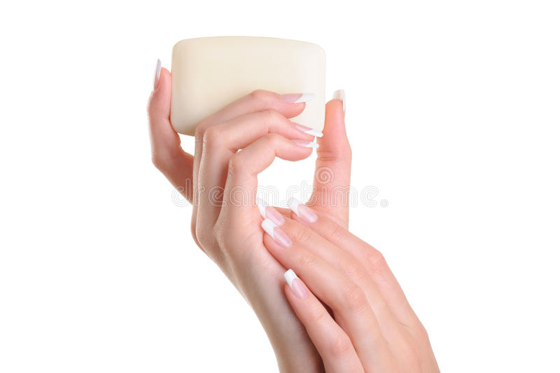 De vrouwen van de schoonheid overhandigen het houden van de witte zeep stock foto's