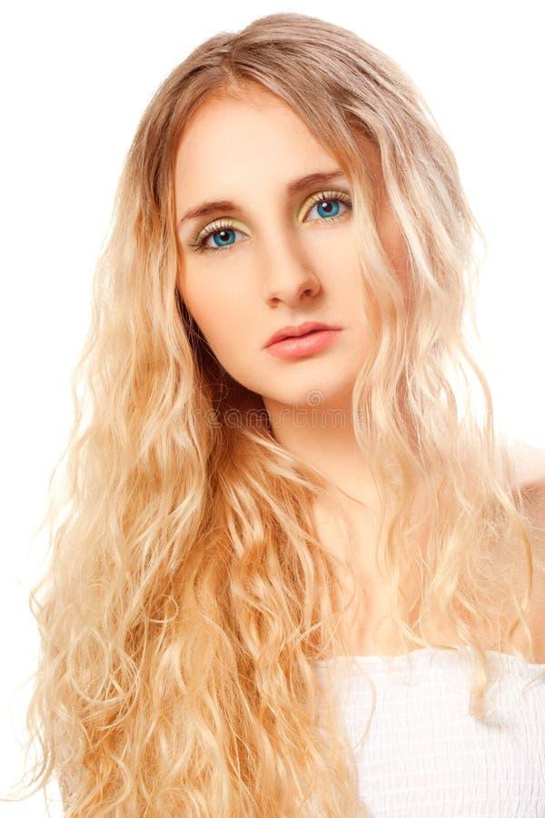 De vrouwengezicht van de close-up met lang krullend haar stock foto's