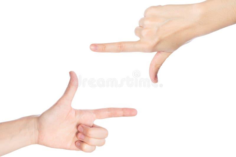 De vrouwenhanden tonen het kadergebaar op een witte achtergrond isoated stock foto's