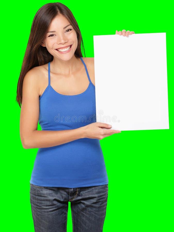 De vrouwenholding die van het teken wit teken toont stock foto
