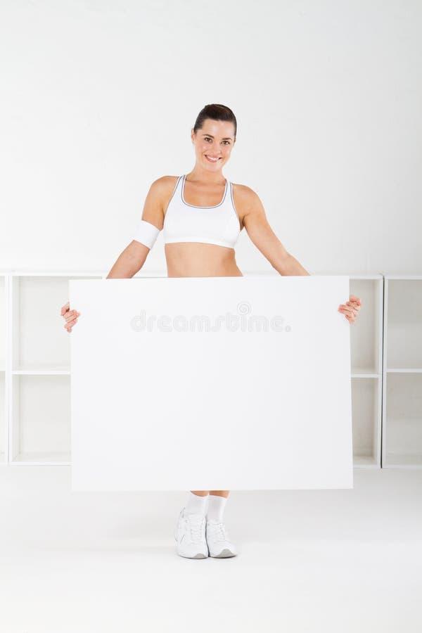De vrouwenholding van de gymnastiek whiteboard royalty-vrije stock afbeelding