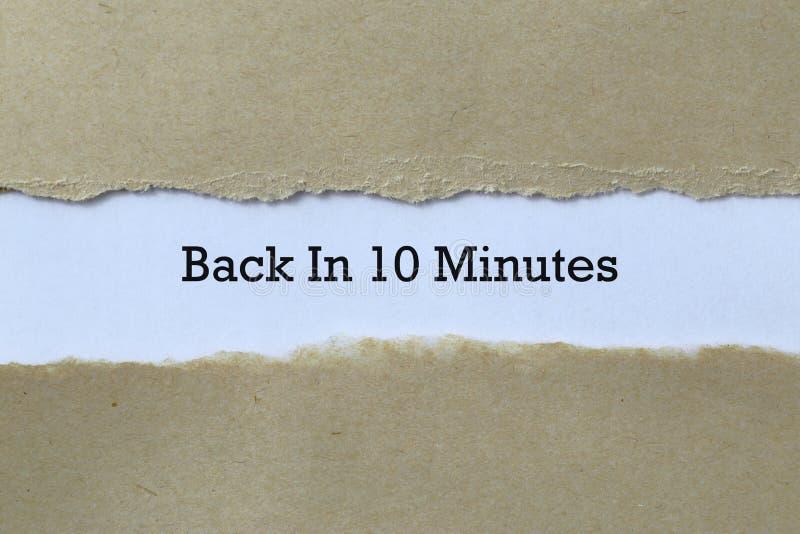 De vuelta en 10 minutos en papel imagen de archivo