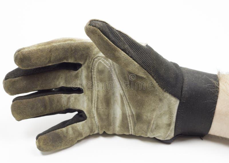 De vuile Handschoen van het Tuinwerk met hand op witte achtergrond royalty-vrije stock afbeeldingen