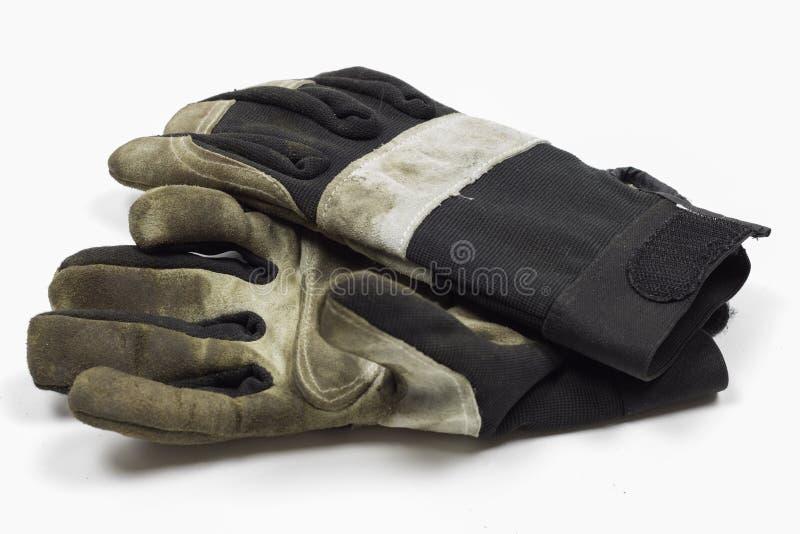 De vuile Handschoenen die van het Tuinwerk op witte achtergrond leggen stock afbeelding