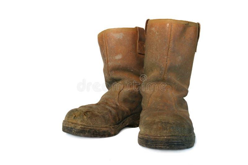 De vuile Laarzen van de Bouwers van het Leer stock foto