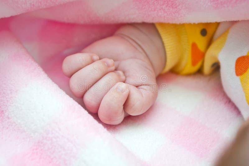 De Vuist van de baby stock afbeelding