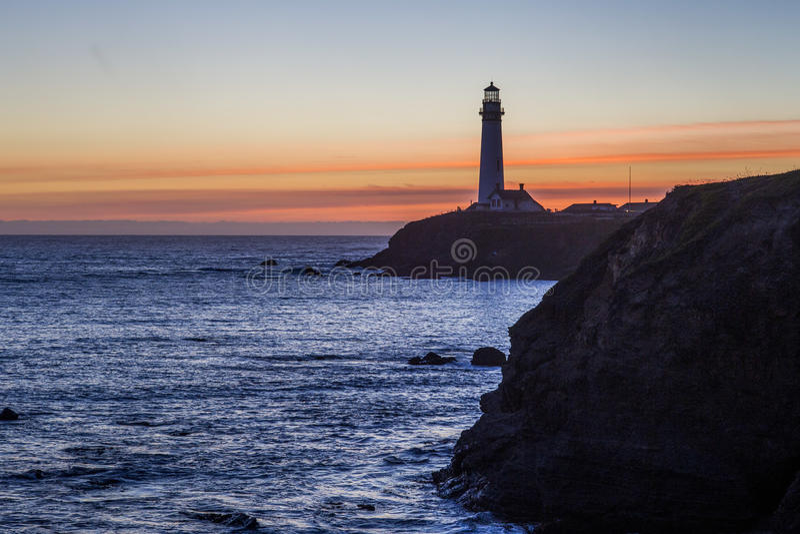 De Vuurtoren van het duifpunt in zonsondergang royalty-vrije stock foto's