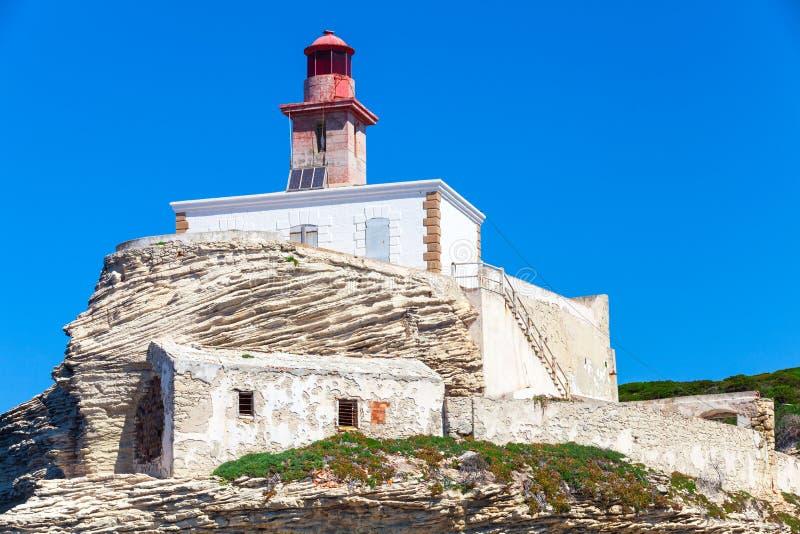 De vuurtoren van La Madonetta Bonifaciohaven, Corsica stock foto