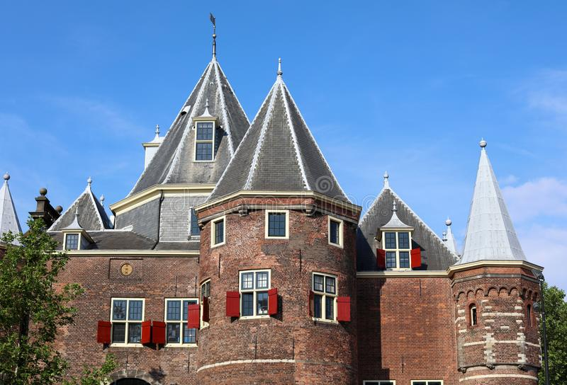 De Waag Castle in Amsterdam, unique historic castle near red light district in The Netherlands. Gorgeous red windows, history. royalty free stock photos