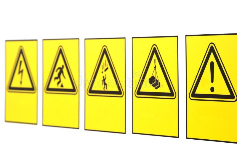 De waarschuwingsborden in de vorm van een driehoek stock foto