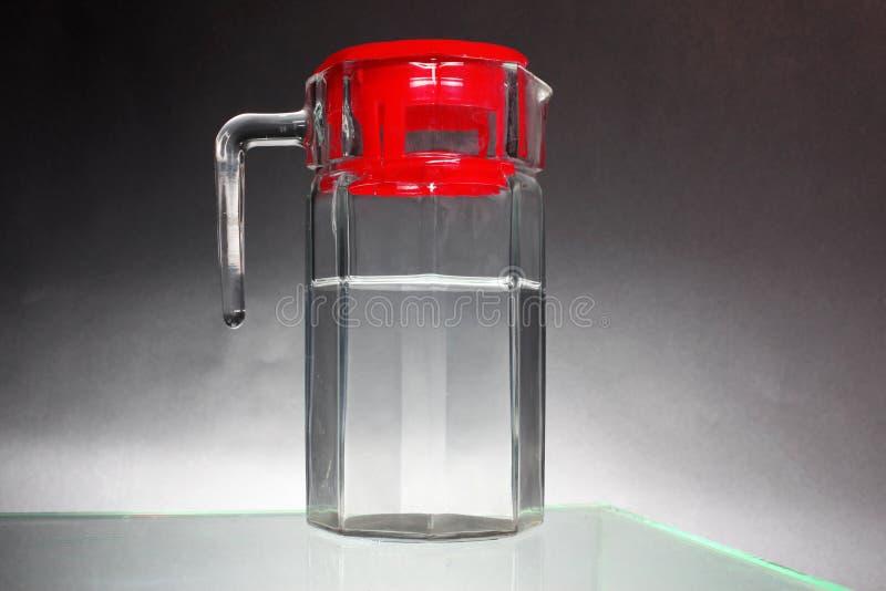 De waterkruik van het glas stock foto