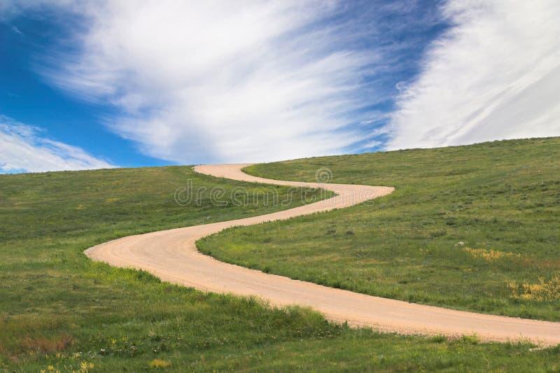 De weg en de hemel van Twisty stock afbeeldingen