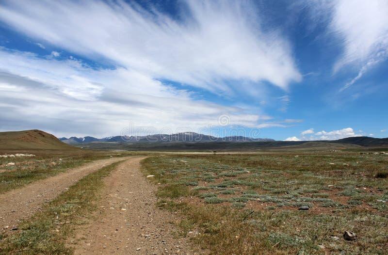 De weg met de wolken stock foto's