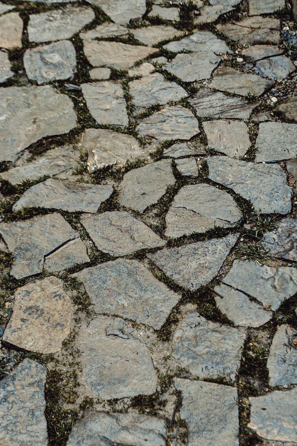 De weg van Cobbled stock afbeeldingen