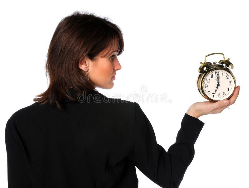 De Wekker van de Holding van de vrouw royalty-vrije stock afbeeldingen