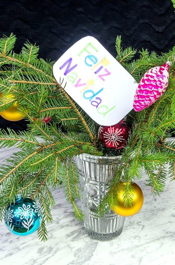 De wens van Vrolijke Kerstmis in het Spaans stock foto's