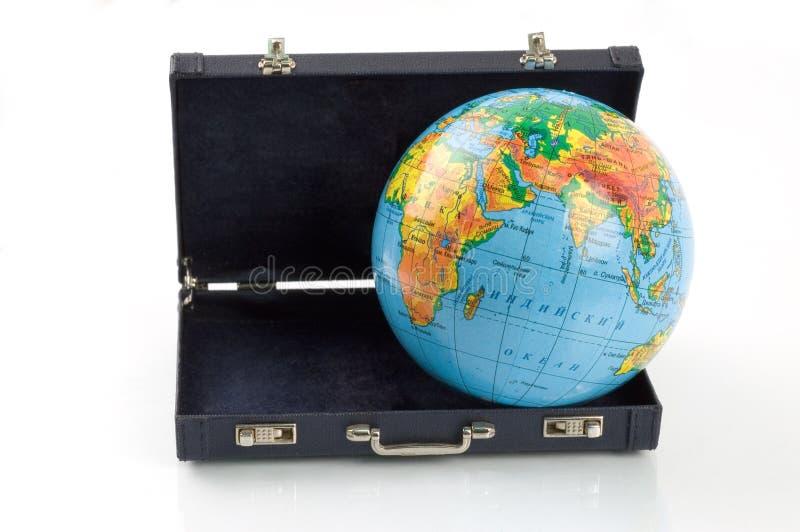 De wereld in een koffer stock foto's