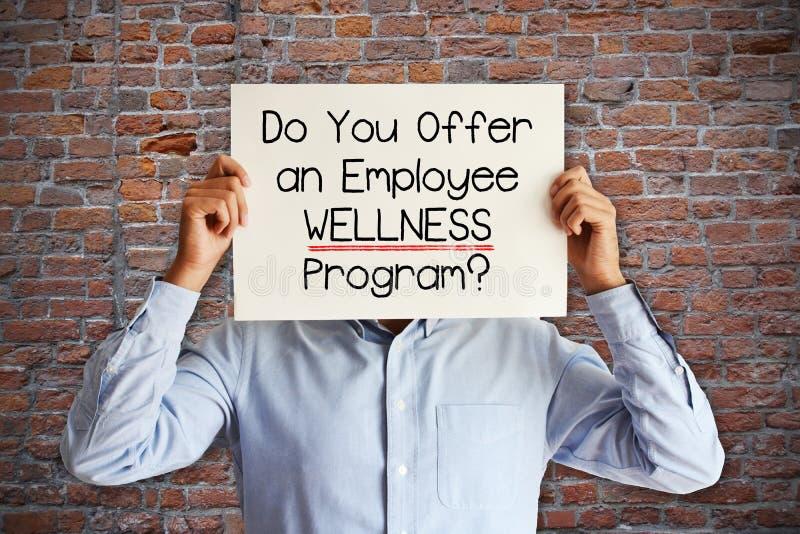 """De werknemer komt ten goede aan concept met het jonge zakenman vragen """"u een programma van werknemerswellness?"""" aanbiedt royalty-vrije stock afbeeldingen"""