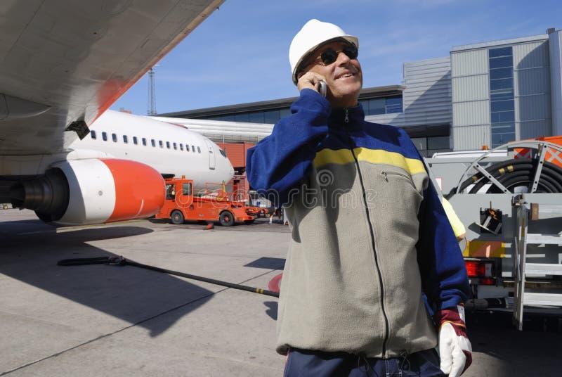 De werktuigkundigen van het vliegtuig in actie stock afbeeldingen