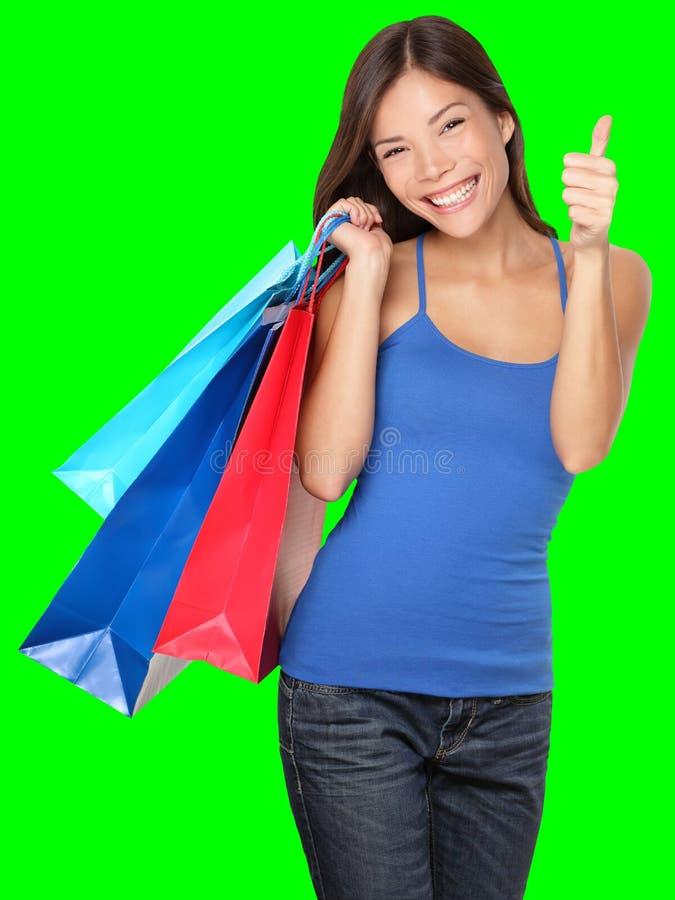 De winkelende vrouw beduimelt omhoog succes stock afbeelding