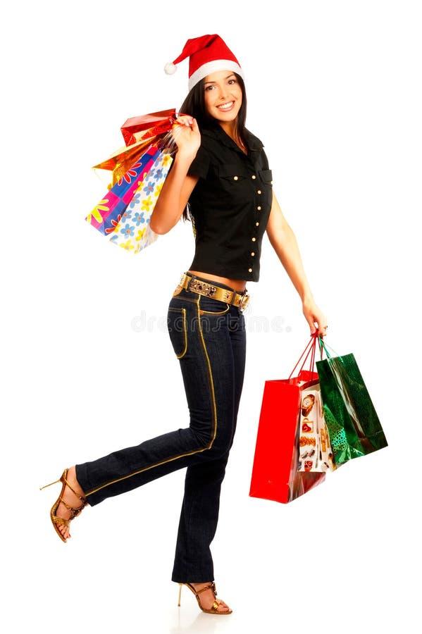 De winkelende vrouw van Kerstmis stock fotografie