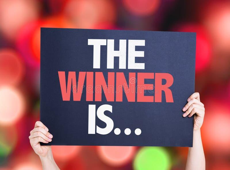 De winnaar is? colorfull mage van een podium kaart met bokehachtergrond stock afbeeldingen