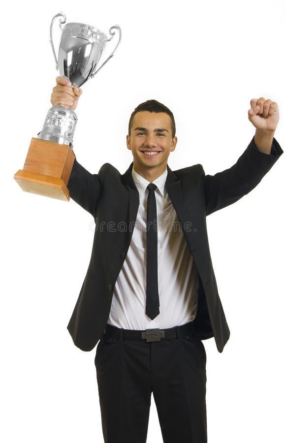 De winnaar van de zakenman met een trofee stock afbeeldingen
