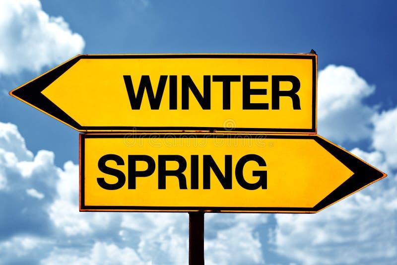 De winter of de lente tegenover tekens royalty-vrije stock afbeeldingen