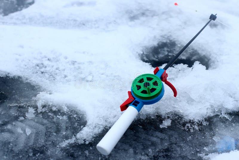 De winter die, de winterwinterappel vissen stock afbeeldingen