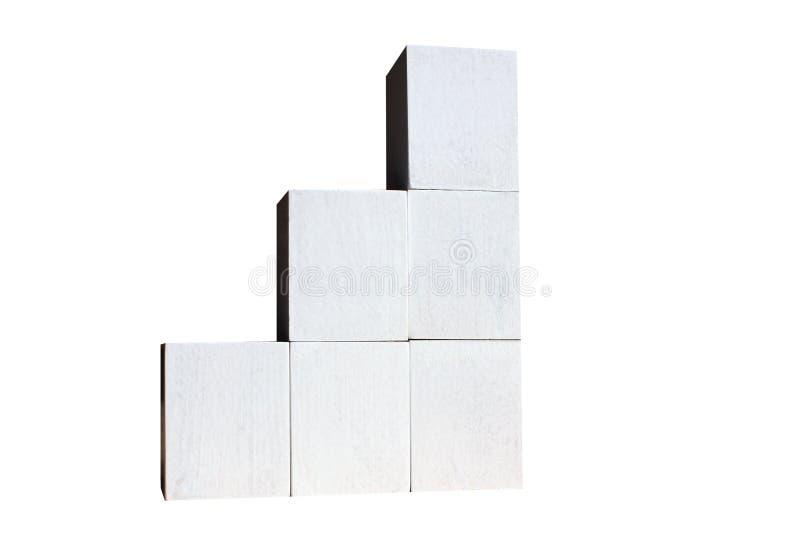 De witte kubussen worden gebouwd als statistieken bedrijfsgrafiek De grafiek en de grafiek, de Webgegevens rapport en de presenta stock foto's