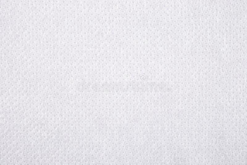 De witte niet-geweven achtergrond van de stoffentextuur stock afbeelding