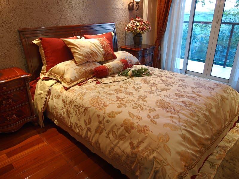 De Woonkamer van het hotel, Bed stock foto's